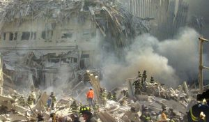 In this Sept. 11, 2001 file photo, a shell of what was once part of the facade of one of the twin towers of New York's World Trade Center rises above the rubble that remains after both towers