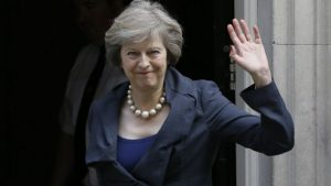Britain's Home Secretary Theresa May waves towards the media as she arrives to attend a cabinet meeting at 10 Downing Street, in London