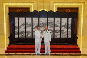 Commander of the Chinese navy, Admiral Wu Shengli (R) shakes hands with U.S. Chief of Naval Operations Admiral John Richardson during a welcome ceremony held at the Chinese Navy Headquarters in Beijing, China, July 18, 2016.