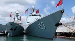 Chinese Peoples Liberation Army Naval Frigate Hengshui (L) is moored next to the PLAN ship Xi'an