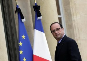 French President Francois Hollande enters the Elysee Palace in Paris