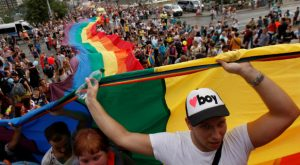 Participants hold a giant rainbow flag during the Prague Pride Parade where thousands marched through the city center in support of gay rights, in Czech Republic