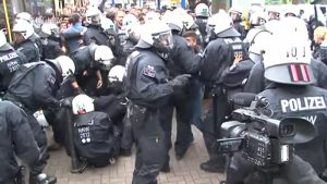 German police are shown deployed to break up a mass brawl between migrants