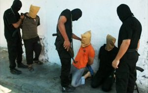 Masked Hamas members (dressed in black) prepare to execute local Palestinians who they claim spied for Israel, Aug. 22, 2014, in Gaza