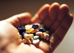 Hand-Holding-Medication-Prescription-Pills-Capsules