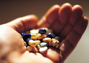 Hand-Holding-Medication-Prescription-Pills-Capsules