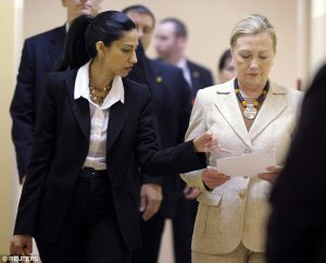 She's with her: Huma Abedin has been at her side for almost 20 years - including when the would-be president was Secretary of State