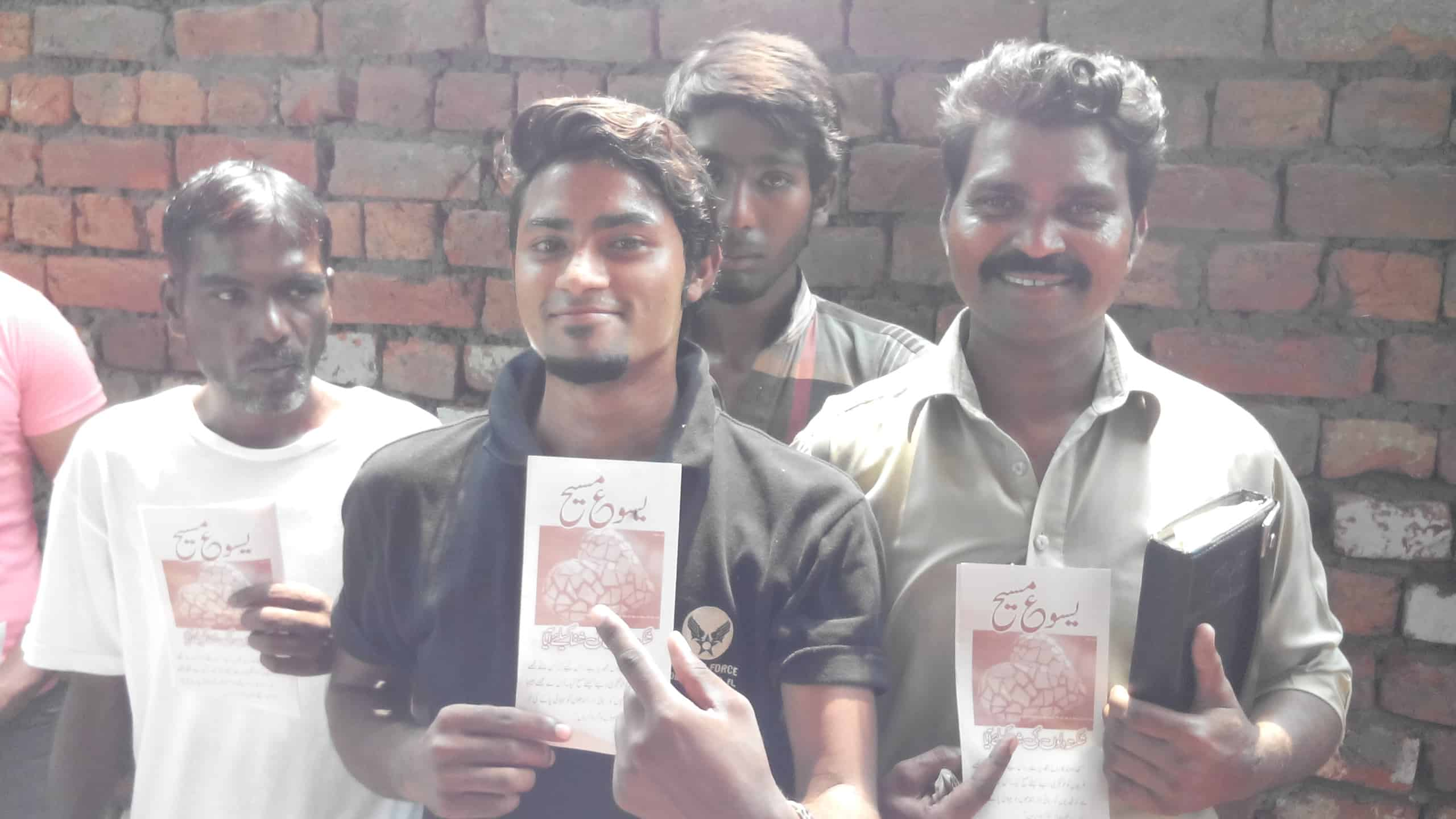 Pakistanis with the brochure - it is brown