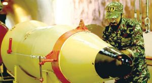 IRGC member inspecting an underground ballistic missile last March, AFP IRGC member inspecting an underground ballistic missile