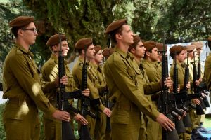 Israeli soldiers stand at attention at the state memorial ceremony marking 10 years since the Second Lebanon War at the Mount Herzl military cemetery in Jerusalem on July 19