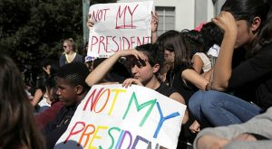Berkeley High student Moria Godes holds a sign saying 'Not My President' during a protest in response to the election of Republican Donald Trump as President of the United States in Berkeley, California