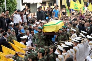 Members and supporters of Lebanon's Shiite militant group Hezbollah carry the coffin of Mustafa Badreddine, a top Hezbollah commander who was killed in an attack in Syria, during his funeral in the Ghobeiry neighbourhood of southern Beirut on May 13, 2016. Hezbollah announced that Badreddine had been killed in an attack in Syria where the Shiite militant group has deployed thousands of fighters in support of the Damascus regime. The group said it was still investigating the cause of the blast near Damascus airport but it did not immediately point the finger at Israel as it did when the commander's predecessor was assassinated in the Syrian capital in 2008. / AFP PHOTO / ANWAR AMRO