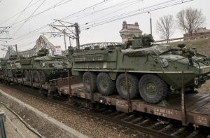 US military armored vehicles are transported on a freight train near the Black Sea port of Constanta, Romania