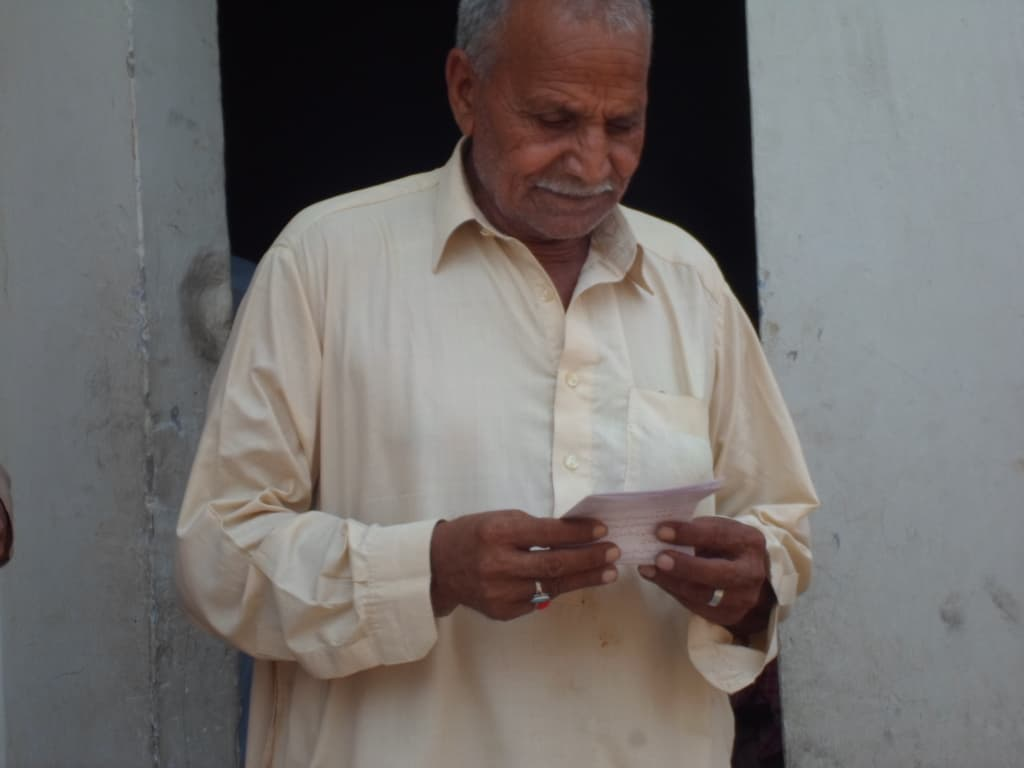 """Pakistani man reading """"Jesus Christ Came to Heal the Brokenhearted""""!"""