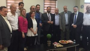 Retired Saudi general Anwar Eshki (center, in striped tie) and members of his delegation, meeting with Knesset members and others during a visit to Israel, on July 22, 2016
