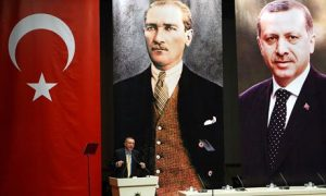 Turkey's PM Recep Tayyip Erdogan addresses the AKP, in front of portraits of himself and Mustafa Kemal Ataturk, the founder of modern Turkey. Critics have accused the PM of creating a cult of personality
