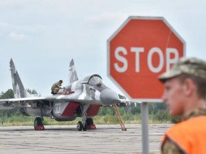 A technician prepares a Ukrainian MIG-29 fighter jet ahead of a training exercise last month