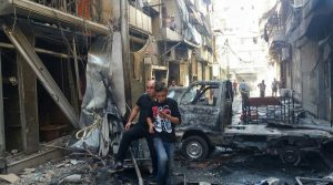 Residents in Midan, a Christian district of Aleppo, hit by mortar shelling