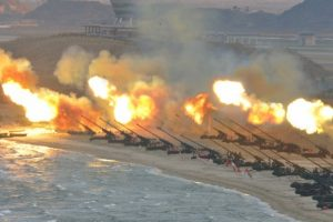 Artillery pieces are seen being fired during a military drill at an unknown location, in this undated photo released by North Korea's Korean Central News Agency