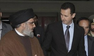 Hezbollah leader Hassan Nasrallah and Bashar Assad.