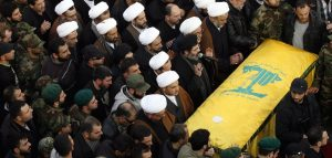 Mourners pray over the casket of Hezbollah military leader Mohammed Issa, a senior commander responsible for Hezbollah operations in Syria and Iraq, one of the six Hezbollah fighters killed in an Israeli strike near Quneitra on the Syrian-controlled side of the Golan Heights, during his funeral in the southern Lebanese village of Arab Salim on January 20, 2015. The attack on January 18 enraged Hezbollah's supporters, but analysts said the group would avoid a major escalation with Israel. AFP PHOTO/MAHMOUD ZAYYAT (Photo credit should read MAHMOUD ZAYYAT/AFP/Getty Images)