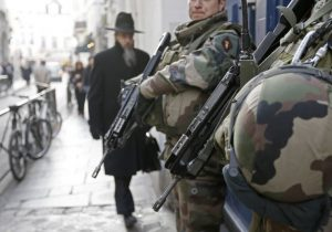 "French soldiers patrol the street in a Jewish neighbourhood near a religious school and a synagogue as part of the highest level of ""Vigipirate"" security plan after the Islamist attacks in Paris January 20, 2015"