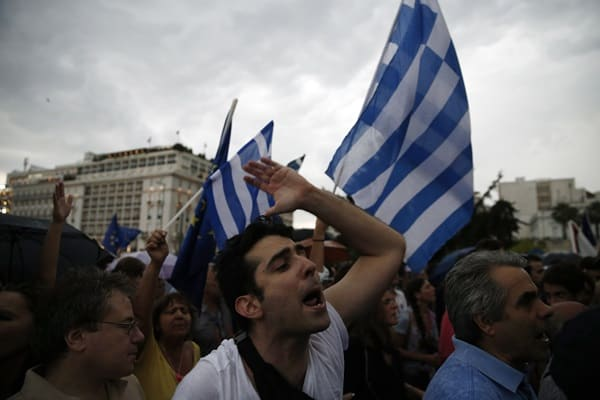 A demonstrator shout slogans during a rally organized by supporters of the YES vote for the upcoming referendum in Athens, Tuesday, June 30, 2015. Greece is set to become the first developed nation to not pay its debts to the International Monetary Fund on time, as the country sinks deeper into a financial emergency that has forced it put a nationwide lockdown on money withdrawals. (AP Photo/Daniel Ochoa de Olza)