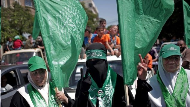 Hamas with green flag which means under control of Islam