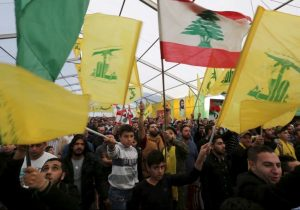 Supporters of Lebanon's Hezbollah leader Hassan Nasrallah wave Hezbollah and Lebanese flags in south Lebanon