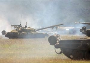 Russian T-80 tanks take part in a tactical military exercise in Armenia