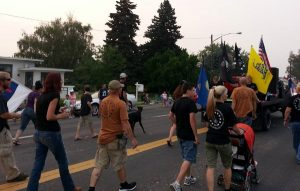 daho residents rally against refugee resettlement in a march through Twin Falls
